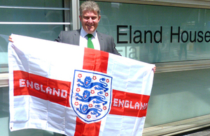 Three Lions flag gleaming above government office in support of England team