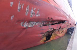 Collision between a cargo ship and an anchored barge